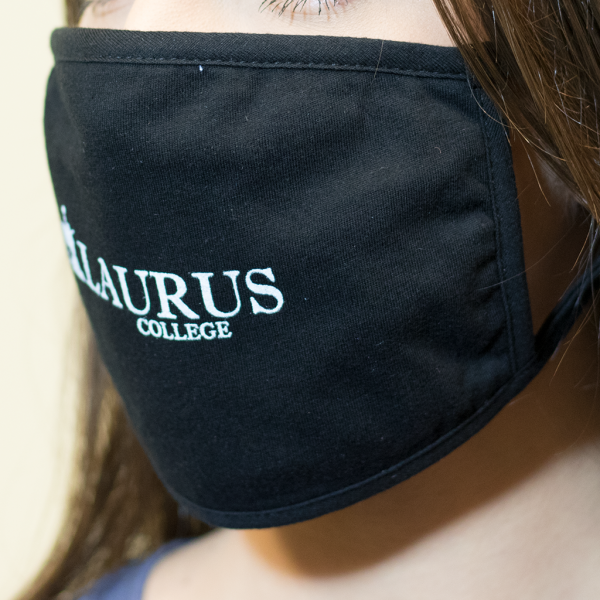 Woman Wearing Laurus College Face Mask